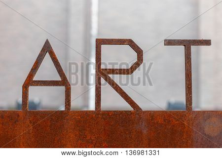 Rusty metal sign. letters ART. old rusty iron