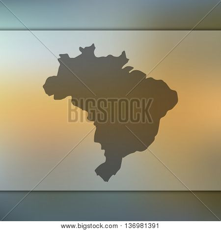 Brazil map on blurred background. Blurred background with silhouette of Brazil.