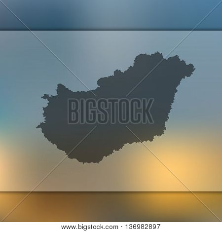 Hungary map on blurred background. Blurred background with silhouette of Hungary. Hungary vector map.
