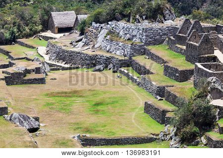 square and ancient houses in Machu Picchu