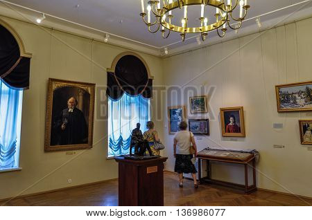 VELIKY NOVGOROD RUSSIA-JULY 1 2016. Interior of the Art Museum - unidentified museum visitors look pictures hanging on the walls in the Art Museum of Veliky Novgorod