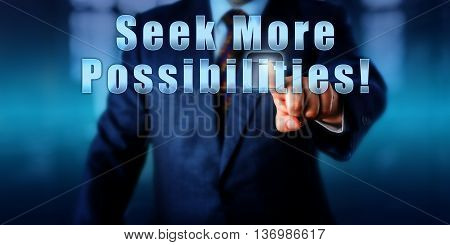 Manager is touching Seek More Possibilities! Motivational metaphor for business development coaching or human resources. Call to action. Torso of man in blue suit over blurred office background.