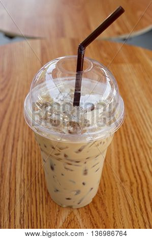 Iced coffee or coffee latte in take-away plastic cup