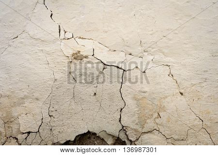Cracked White Wall With Large Fissure