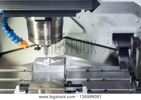 CNC Milling operation on the sample work pieces the CNC milling machine while cutting the sample work piece