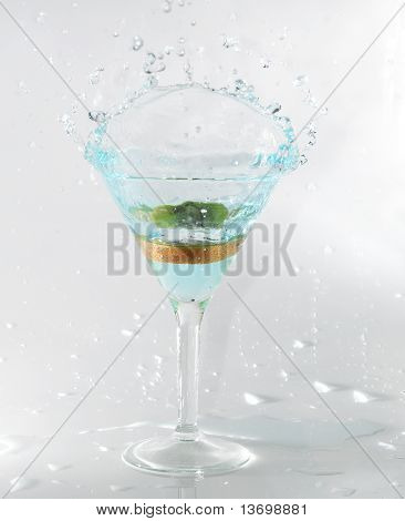 splashing on blue martini