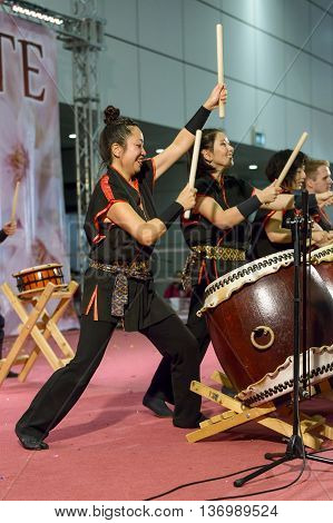 Bologna, Italy - February 27, 2016: at the fair Festival of the East in Bologna, the spectacle of Masa Daiko group, players of ancient Japanese drums