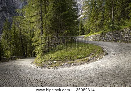 Winding mountain pavement road - a turn