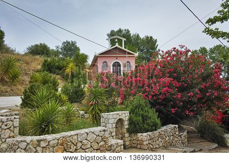Orthodox church with spring flowers, Kefalonia, Ionian islands, Greece