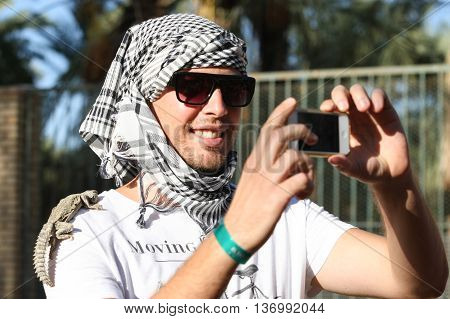 Tourist Taking Selfie With Desert Monitor