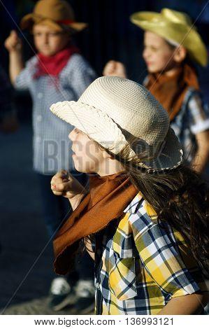 Montenegro, Herceg Novi - 04/06/2016: Dance of the little cheerful cowboy. 10 International Children's Carnival