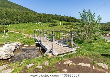 wooden bridge over river in Pirin Mountain near Bezbog lake, Bulgaria