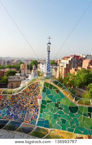cityscape of Barcelona with bench of park Guell at summer, Spain