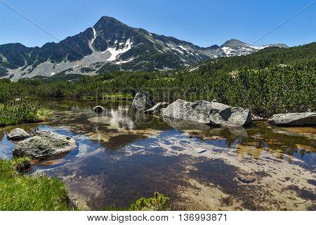 Reflection of Sivrya peak in Banski lakes, Pirin Mountain, Bulgaria
