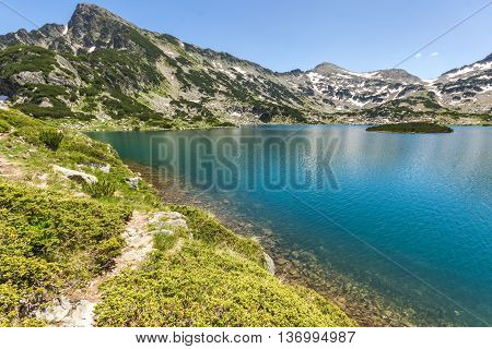 Sivrya peak and clear waters of Popovo lake, Pirin Mountain, Bulgaria