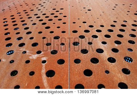 Rusty metallic background with holes
