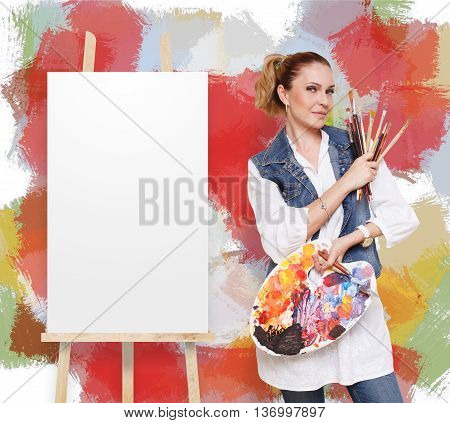 Happy artist. Woman with art tools. Female painter with brushes and palette. Empty easel with canvas at colorful background with copy space. Art classes for adults, education concept.