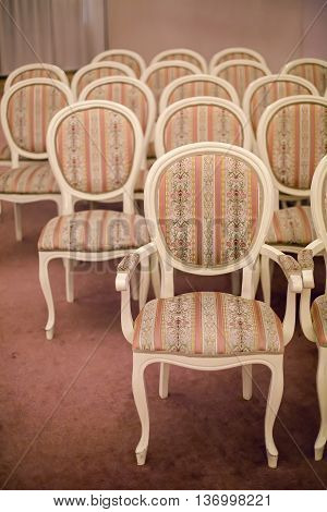 bright chairs in the art Nouveau style in the great hall of the wedding Palace in Pushkin in Saint-Petersburg