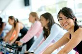 stock photo of gym workout  - Women At The Gym Doing Cardio Exercises - JPG