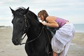 Woman Mount A  Horse On The Beach
