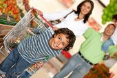 picture of grocery-shopping  - Family shopping for some groceries at the supermarket - JPG