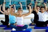 picture of gym workout  - Group of people exercising at the gym with freeweights - JPG