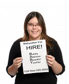 picture of babysitter  - A babysitter holding a paper flyer advertising her skills as a babysitter isolated against a white background - JPG