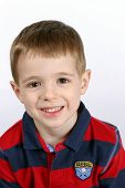 image of young boy  - cute boy with big brown eyes smiling - JPG