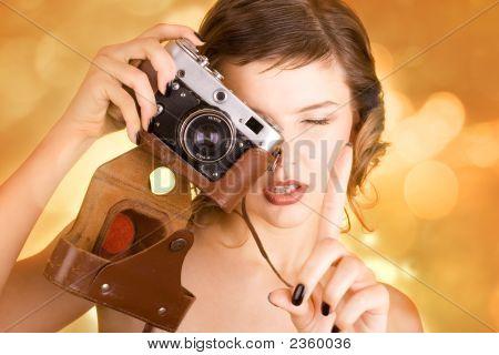 Glamorous Girl Holding A Camera