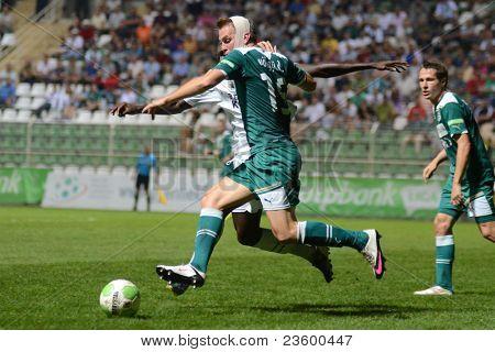 KAPOSVAR, HUNGARY - SEPTEMBER 10: Daniel Volgyi (green 15) in action at a Hungarian National Championship soccer game - Kaposvar (white) vs Gyor (green) on September 10, 2011 in Kaposvar, Hungary.