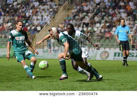 KAPOSVAR, HUNGARY - SEPTEMBER 10: Mustapha Diallo (in white) in action at a Hungarian National Championship soccer game - Kaposvar (white) vs Gyor (green) on September 10, 2011 in Kaposvar, Hungary.