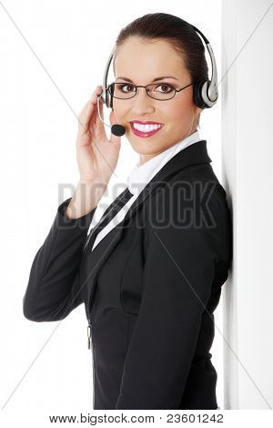Portrait of a successful young female call centre employee wearing a headset against white background