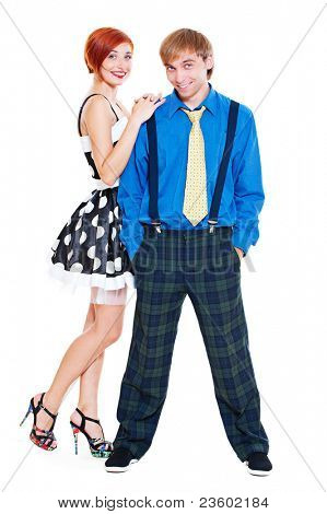 couple of rock and roll dancers posing over white background