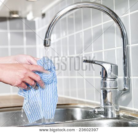 Dish Cloth Under Running Water