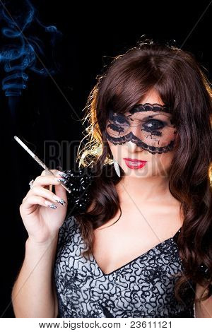 smoking brunette girl with lacy mask
