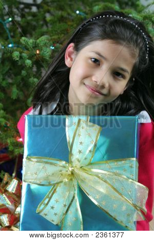 Eight Years Old Girl Holding Christmas Present