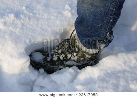 Mans Boot Making Print In Deep Snow.