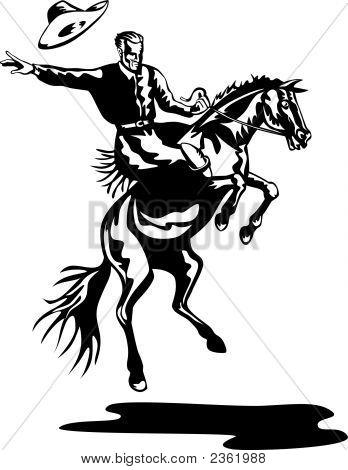 Rodeo Cowboy Riding A Bucking Bronco
