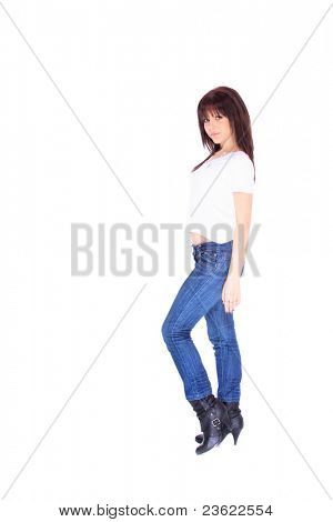 smiling young woman in jeans and t shirt, studioshot over white background