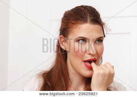 Woman tasting chocolate