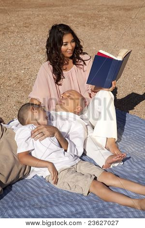 Woman Read Family Sand