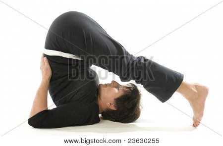 Middle Age Woman Demonstrating Yoga Position Halasana The Plough