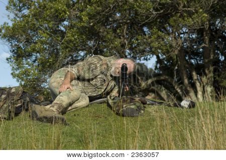 Hunter With Spotting Scope