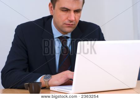 Businessman Working On White Computer