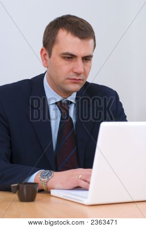 Serious Businessman Working On Lap-Top