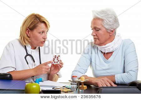 Doctor Explaining Medication To Senior Woman
