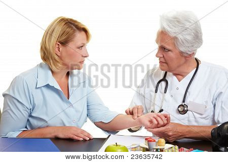 Doctor Feeling Pulse With Fingers
