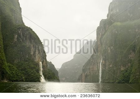 Two Falls in Misty Day Sumidero Canyon in Chiapas Mexico, the wall of rock reach 1600 yards (1000 meters)