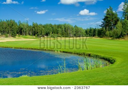 Golf Fairway Along A Pond