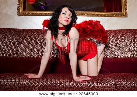 Hooker With Angel Wings Posing On Couch
